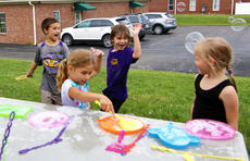"<div class=""source"">KACIE GOODE/The Kentucky Standard</div><div class=""image-desc"">Kids play with bubbles during Bardstown Primary School's Tigerpawlooza Friday.</div><div class=""buy-pic""><a href=""/photo_select/95854"">Buy this photo</a></div>"