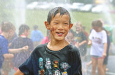 "<div class=""source"">KACIE GOODE/The Kentucky Standard</div><div class=""image-desc"">A waterfall created by a fire engine hose was a big hit at Friday's Tigerpawlooza, Bardstown Primary School'ss end-of-year celebration.</div><div class=""buy-pic""><a href=""/photo_select/95861"">Buy this photo</a></div>"
