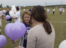 """<div class=""""source"""">PETER W. ZUBATY/The Kentucky Standard</div><div class=""""image-desc"""">Former Thomas Nelson and current Eastern Kentucky University soccer player Claire Hicks, center, distributes balloons for release during the ceremonies at the Taylor Martin Memorial Game Monday against Nelson County. Hicks organized the event last year as a way to honor Martin, her former teammate who died two years ago in an automobile accident. Proceeds from the game go to fund the Taylor Martin Memorial Scholarship.</div><div class=""""buy-pic""""></div>"""