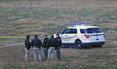 """<div class=""""source"""">KACIE GOODE/The Kentucky Standard</div><div class=""""image-desc"""">Law enforcement officers gather in a field on a property off Ed Brent Lane Saturday morning. Family members of Tommy Ballard confirmed he had been shot and killed on the property, but it is unclear if the shooting was an accident or intentional.</div><div class=""""buy-pic""""><a href=""""/photo_select/81323"""">Buy this photo</a></div>"""