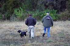 """<div class=""""source"""">KACIE GOODE/The Kentucky Standard</div><div class=""""image-desc"""">A K-9 unit walks off into a field Saturday morning after a man, identified by family as Tommy Ballard, was reportedly shot off of Ed Brent Lane. It has not been confirmed if the shooting was accidental or intentional.</div><div class=""""buy-pic""""><a href=""""/photo_select/81325"""">Buy this photo</a></div>"""
