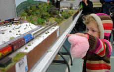 "<div class=""source"">KACIE GOODE/The Kentucky Standard</div><div class=""image-desc"">Adalia Beams, 2-and-half, clutches a stuffed animal while pointing to a train as it moves around the model track. A snowy April day brought dozens of families with young kids out to the Kentucky Railway Museum's annual Train Show, housed in the St. Catherine Academy gym.</div><div class=""buy-pic""><a href=""/photo_select/94354"">Buy this photo</a></div>"