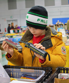 "<div class=""source"">KACIE GOODE/The Kentucky Standard</div><div class=""image-desc"">Andrew Perks, 9, of Radcliff, looks at model trains for sale Saturday during the Kentucky Railway Museum's annual Train Show and Sale at the St. Catherine Academy gym. </div><div class=""buy-pic""><a href=""/photo_select/94356"">Buy this photo</a></div>"