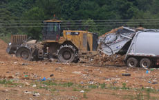 """<div class=""""source"""">RANDY PATRICK/The Kentucky Standard</div><div class=""""image-desc"""">Earth-moving equipment and a garbage truck operate at the Nelson County Landfill.</div><div class=""""buy-pic""""></div>"""