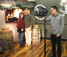 """<div class=""""source"""">RANDY PATRICK/The Kentucky Standard</div><div class=""""image-desc"""">Tony and Lora Villier of Louisville pose for a picture by Oscar Bojorquez at the Jim Beam American Stillhouse Friday night before being seated for dinner at the Holiday Feastival.</div><div class=""""buy-pic""""><a href=""""/photo_select/91468"""">Buy this photo</a></div>"""