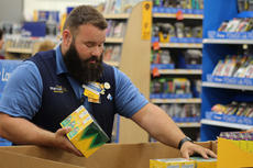 """<div class=""""source"""">JOHN SINGLETON/The Kentucky Standard</div><div class=""""image-desc"""">Glenn Frost visits from the Lebanon store to help local employees stock new inventory for Walmart&#039;s grand re-opening.</div><div class=""""buy-pic""""><a href=""""/photo_select/104472"""">Buy this photo</a></div>"""