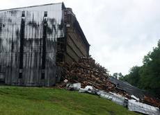 "<div class=""source"">Photo submitted</div><div class=""image-desc"">A rickhouse at Barton 1792 Distillery in Bardstown partially collapsed Friday morning, spilling an estimated 9,000 barrels onto a hillside. No one was reported injured in the collapse.</div><div class=""buy-pic""><a href=""/photo_select/96302"">Buy this photo</a></div>"