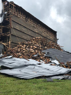 "<div class=""source"">Photo submitted</div><div class=""image-desc"">A rickhouse at Barton 1792 Distillery in Bardstown partially collapsed Friday morning, spilling an estimated 9,000 barrels onto a hillside. No one was reported injured in the collapse.</div><div class=""buy-pic""><a href=""/photo_select/96304"">Buy this photo</a></div>"