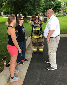 """<div class=""""source"""">SUBMITTED PHOTO</div><div class=""""image-desc"""">Jill Mattingly, center, Bardstown's newest trained volunteer firefighter, suits up for a flashover exercise Saturday morning. She is the daughter of Fire Chief Billy Mattingly, right. At left are two other new recruits who are going through training, Tracy Sinovitz and Jessica Brothers.</div><div class=""""buy-pic""""></div>"""