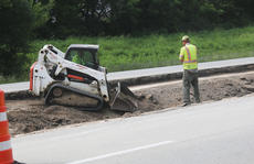 "<div class=""source"">RANDY PATRICK/The Kentucky Standard</div><div class=""image-desc"">A worker uses a Bobcat to do some grading work to build a crossover from the eastbound to westbound side of the Bluegrass Parkway to divert traffic while lanes are closed between Exits 21 and 25.</div><div class=""buy-pic""></div>"
