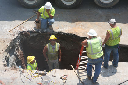 JUNE 2010: The hole beside Hurst Drug Store may have startled some passersby, but it was there for a reason as workers continued laying new waterline along North Third Street from Broadway Avenue to Court Square and around the square, tying in to a major line near Bethlehem High School. The new line will improve downtown water pressure, including that of fire hydrants and sprinkler systems, and will provide another looping method in case of a break. After the waterline is completed, work will begin on the Streetscape downtown beautification project.(Published June 27, 2010.)
