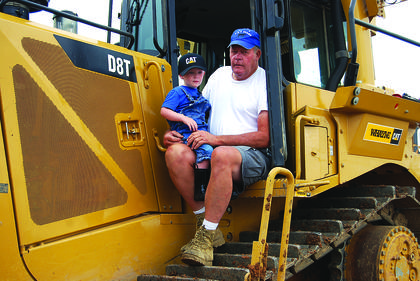 "Will White stopped in to visit his ""Papaw,"" Joe Boone, at a Maker's Mark warehouse site on July 1 and got to pretend to drive a bulldozer."