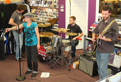 Louisville-based band Anton Mink played an in-store show recently at Wooden Duck Entertainment. Lead singer Chloe Mardis, front left, is a Bardstown resident.