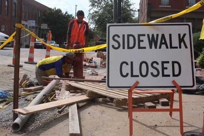 AUGUST 2010: A Streetscape construction crew works on laying brick and removing old sidewalk at the corner of Flaget Avenue and North Third Street near Town & Country Bank. (Published Aug. 27, 2010.)