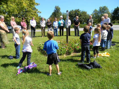 "St. Joseph Montessori students celebrated Peace Day by singing 'I've Got Peace Like a River"" at the Peace Pole on the Sisters of Charity of Nazareth property."