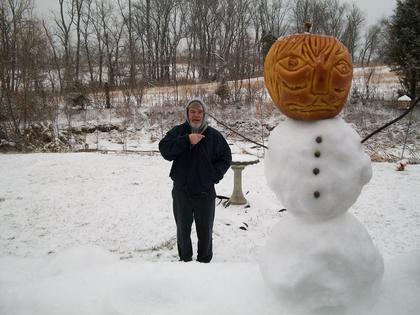 """Leo Lyvers, Bardstown, took this photo from his back porch on Andrea Court. He calls it the """"attack of the snow apple."""" It's """"somewhat of an optical illusion. The snow apple is only about 8 inches tall."""""""