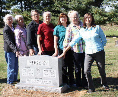 """The children of the late Gerald and Helen Rogers of Culvertown dedicated a new monument in St. Thomas Cemetery to their grandparents, Malachi S. """"Mals"""" Rogers and Martha B. """"Mattie"""" Greenwell Rogers and their youngest daughter, Louise Blanche """"Lula"""" Rogers on Oct. 21. Pictured from left are Mary Virginia, Ruth Ann, Gary, Wanda Joan, Linda, Dinnie and Elizabeth"""