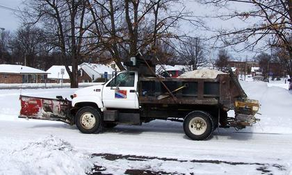 A Bardstown City plow moves snow on West Muir Avenue at Cathedral Manor in Bardstown.