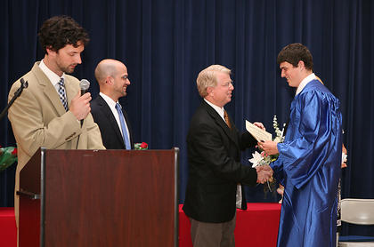 "Rep. David Floyd presents the graduates a ""Letter of Citation"" from the KY House of Representatives."