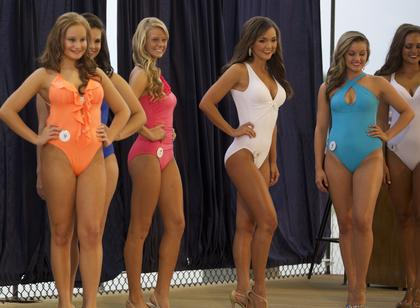 Contestants in the Miss Nelson County Fair pose in swimsuits for the judges Monday night.