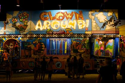 Fair patrons cycle in and out of one of the carnival amusements Monday night at the Nelson County Fair.