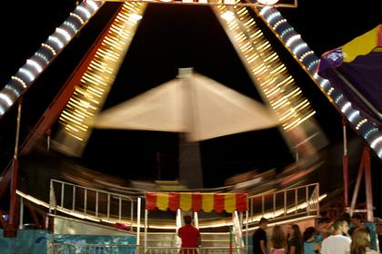 The Pirate Ship ride swings by in a blur during Monday night's Nelson County Fair.