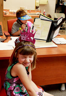 "Travis Wise plays with the telephone while Emma Spiker enjoys her new ""crown."" The students attended a Summer Time Early Preparation program in June to prepare for entering the third grade at Bardstown Elementary School. The program was organized by the district's Family Resource and Youth Services Center."