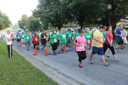 The walkers begin their five kilometers in the Run for the Health of It benefit for the Nelson County Community Clinic Saturday. Partipants could walk, jog or run.