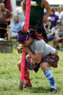 Amanda Blue clasps her hands together as she tries to pick up a caber during a caber toss at the annual Highland Games at Heaven Hill Distilleries Aug. 17.