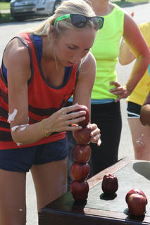 A participant in the second annual HeartChase event focuses as she stacks apples in one of the many obstacle courses featured in the event, which benefited the American Heart Association. According to Heather Mattingly, director of cardiopulmonary services at Flaget Memorial Hospital, the event raised more than $17,500 and had 118 players on 38 teams. Mattingly said Flaget's team, Flaget Surgery's Thrift Shop Thrillers, raised the most money ($4,735.54) for the event.