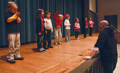 """Children hoping to land a part in the Stephen Foster Drama Association's production of """"Wizard of Oz"""" excitedly react to instructions from Johnny Warren, the association's managing artistic director, at a tryout Monday night at Bardstown High School. From left, the potential munchkins, flying monkeys and Oz residents were Bailey McMillen, 6; Savannah Childress, 7; Hallie Hurst, 5; Thomas Fell, 6; Isabella Riggs, 7; Ava Roby, 4; Braden Greer, 5; and Ruby Grace Hovious, 8."""