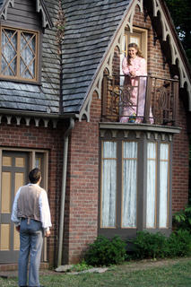 """Stephen Foster, as portrayed by Bronson Norris Murphy, calls talks to Jane McDowell, portrayed by Charlotte Campbell, from her balcony during a rehearsal of """"The Stephen Foster Story"""" Wednesday night."""
