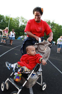 Renee Lydian Fray and her son, Jayden Fray, 11 months, wear matching Jim Beam Team shirts at their first Relay for Life event together May 13, 2011. Several family members have been affected by cancer, Fray said.