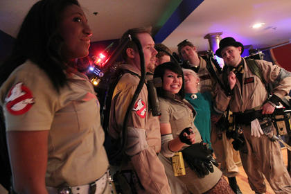 Ghostbusters pose with Jeanette Cantrell. Pictured are, from left, Jacqueline Walker, John Gritton, Chip Gillock, Katrina Bidwell, Jeanette Cantrell, Jonathan Peacock, and Ryan Kemp.