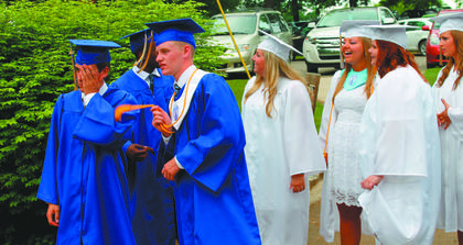 Bethlehem High School seniors talked and laughed while waiting outside the amphitheater for the school's commencement exercises to commence. Seventy-two students graduated Sunday.