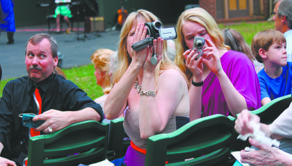 Audience members took pictures and videos of Bethlehem High School graduates as they made their way down the steps at the J. Dan Talbott Amphitheatre Sunday night.