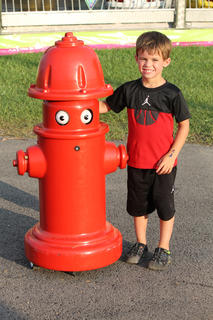 Blake Mudd, 4, poses with his new friend at the fair, a robotic fire hydrant. The walking, talking fire hydrant was controlled by Bardstown-Nelson County firefighters. Fortunately, dogs weren't allowed.