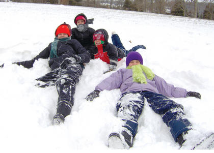 """Katrina, Caroline, Jackson and Lincoln Boone take time for a break while playing in the snow recently. Submit your """"Fun in the Snow"""" pictures online."""