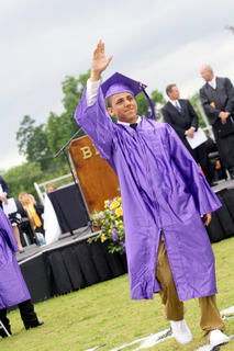Brey Stivers waves to friends and family during Bardstown High School's graduation Saturday.