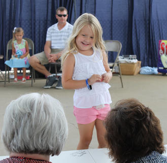 Charli Nicole Berry, daughter of Amber Shane and Kevin Berry, auditions for the judges at the Nelson County Fair.
