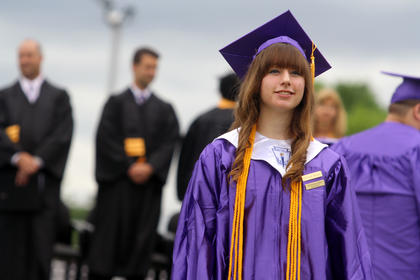 Christine Seaman looks for her family as she walks into Bardstown High School's graduation Saturday.