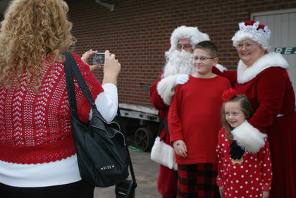 The Doyle family from Bowling Green visited New Haven's Christmas celebration. John Tyler and his sister, Kimber, posed for photos with Santa and Mrs. Claus after taking a train ride at the Kentucky Railway Museum.