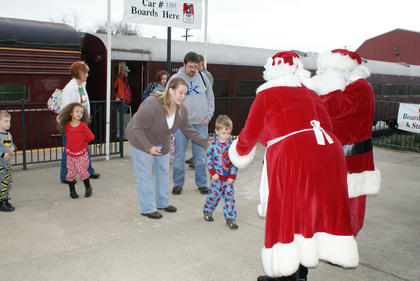 Kelly and Braden Crain of Glasgow encouraged their son Caleb to visit with Santa and Mrs. Claus at the Kentucky Railway Museum.