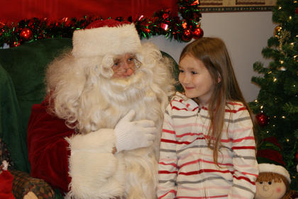 AT LEFT —  After the Christmas parade, families had a chance to visit with Santa at New Haven City Hall. Carmen dell' Agnello, 7, told Santa she'd like a pig for Christmas.