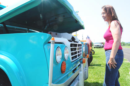 "Dawn Melbin, Bardstown, takes a look at a truck that was brought to the show. The show was open to tractors and farm ""toys"", meaning antique engines, trucks and machinery."