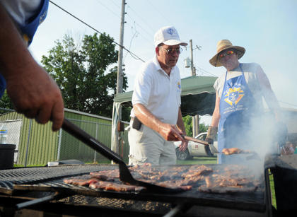 Richad Kelty and Don Clark, Knights of Columbus, cook rib-eyes on the grill at the Salt River Electric Picnic.