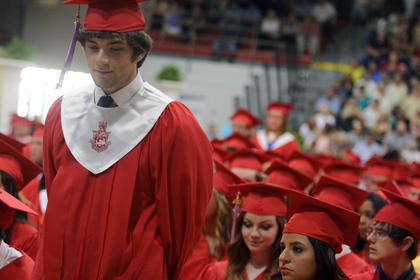 Dylan Beasley stands as he gets recognized for graduating cum laude from Nelson County High School Friday.