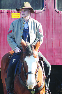 """A re-enactor sits atop his horse before a """"Great Train Robbery"""" at the Kentucky Railway Museum."""