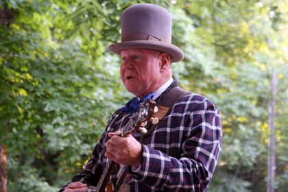 """Gary Viditoe, in his costume for """"The Stephen Foster Story,"""" plays banjo for a group of people at Doo Dah Day Saturday in front of the J. Dan Talbott Amphitheatre."""