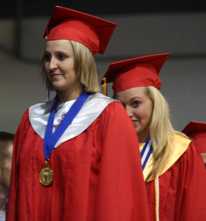 Students wait in line to receive their diploma.